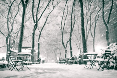 New York City - Winter Night as Snow Falls on Bryant Park