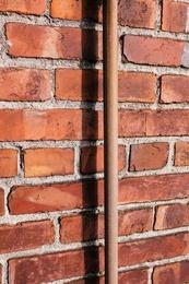 Brown Pipe, Brick Wall