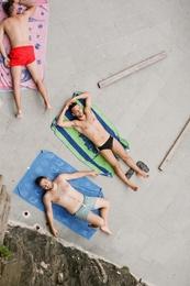 Sunbathers in Manarola, Italy