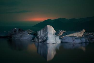 Jökulsárlón Under a Volcano's Glow